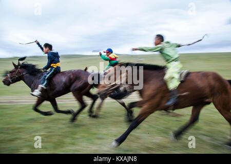 The horse races are by age five years with the riders no older than 13 years of age when they retire. Many of the - Stock Photo