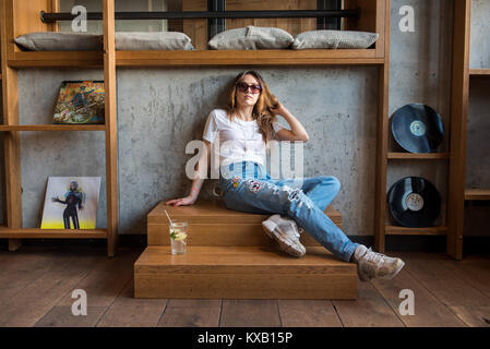 Hamburg, Germany. 21st Sep, 2017. Rapper Haiyiti (Ronja Zschoche) sits on a stair landing in Hamburg, Germany, 21 - Stock Photo