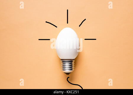 Light Bulb Egg shell on Base Concept  Energy Saving  - Stock Photo
