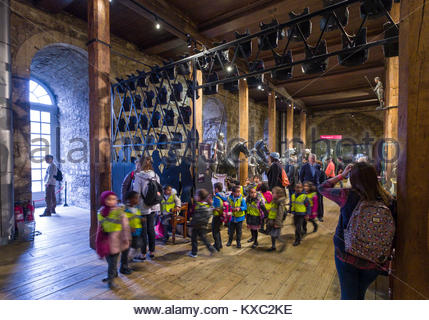 Group of school children on tour of the Line of Kings Exhibit inside the White Tower, Innermost Ward, Tower of London, - Stock Photo