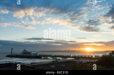 View over Bournemouth seafront and Bournemouth Pier during sunset in January 2018, Dorset, England, UK - Stock Photo