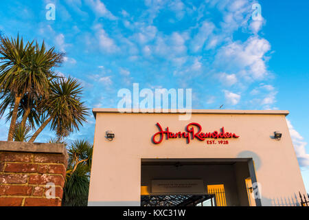 The Harry Ramsden Fish and Chips Restaurant at Bournemouth seafront during evening light against blue sky in January - Stock Photo