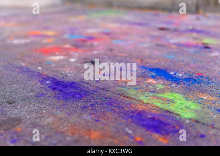 Macro closeup of colorful chalk art on ground with purple, blue and green colors on asphalt street sidewalk in urban - Stock Photo
