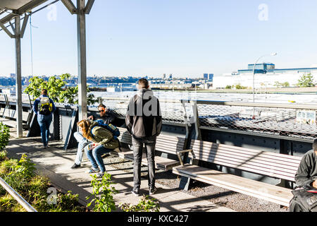New York City, USA - October 27, 2017: Highline, high line, urban garden in NYC with many people tourists sitting - Stock Photo