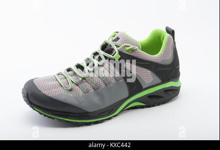 Outdoors shoe for man for different activities, trail running, free running, fast climbing, hiking, studio shoot - Stock Photo