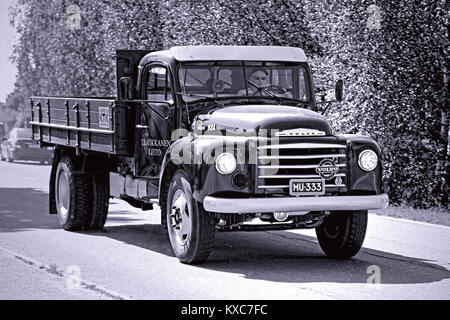 KOSKI TL, FINLAND - JULY 26, 2014: Classic Volvo N84 truck  year 1966 on the road, photo converted in black and - Stock Photo