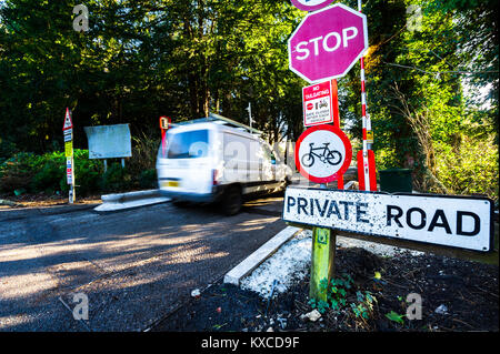 Signs and barriers to a private road. - Stock Photo