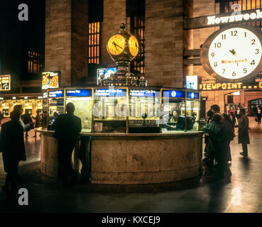 May 1982,New York,Grand Central train station main concourse,subway and city bus information booth,clocks,Manhattan,New - Stock Photo