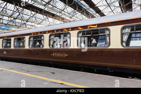 A preserved Pullman carriage is pictured in Carlisle Citadel station in Cumbria.  Pullman was a luxury railway service - Stock Photo