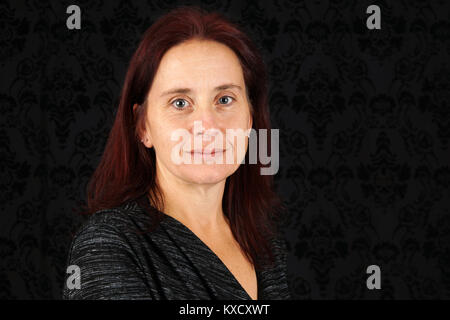 Portrait of a serious and calm middle aged caucasian woman - Stock Photo