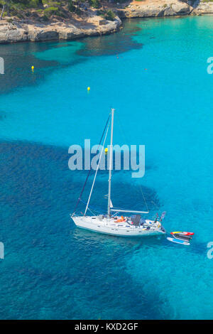 View of Cala Macarella and sailboat, Menorca, Balearic Islands, Spain - Stock Photo
