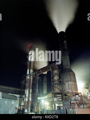 Low angle view of smoke emitting from industry against sky at night - Stock Photo