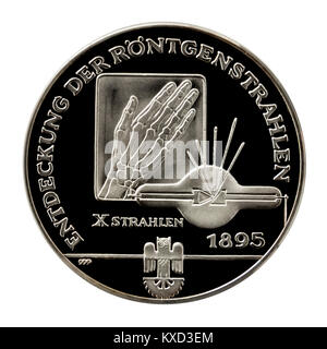 99.9% Proof Silver Medallion celebrating the discovery of X-rays by Wilhelm Conrad Röntgen, the famous German inventor. - Stock Photo