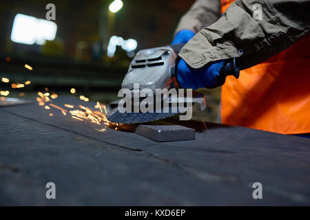Steel Plant Worker Using Angle Grinder - Stock Photo