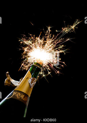 Champagne cork popping on a black background. - Stock Photo