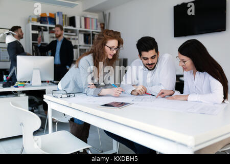 Group of architects working together on project - Stock Photo