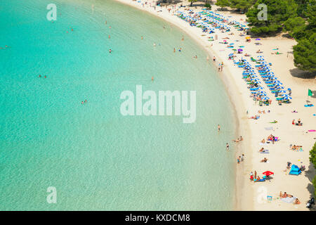 Bathers at Cala Galdana,Menorca,Balearic Islands,Spain - Stock Photo
