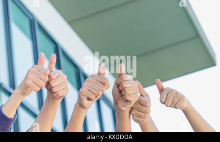 close up group of hand thumbs up at office building,good success business concept - Stock Photo
