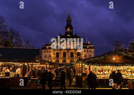 Town hall with Christmas market,colorful illuminated around Christmas time,Lüneburg,Lower Saxony,Germany - Stock Photo