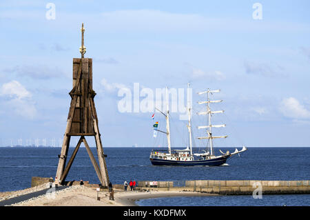 Kugelbake with sailing ship on the Elbe,mouth of the Elbe into the North Sea,landmark of the city of Cuxhaven,Lower - Stock Photo