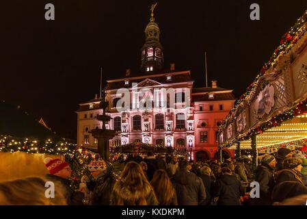 Town hall with Christmas market, colorful illuminated around Christmas time, Lüneburg, Lower Saxony, Germany - Stock Photo