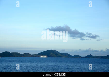 Cruise ship anchored off the coast of Basse Terre, St Kitts, Caribbean with copy space. - Stock Photo