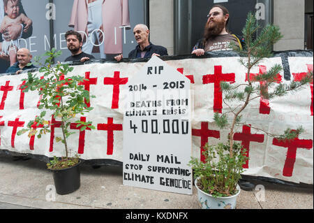 Protesters hold a tombstone and banner with crosses at the 48 hour protest by Occupy aimed at getting the Daily - Stock Photo