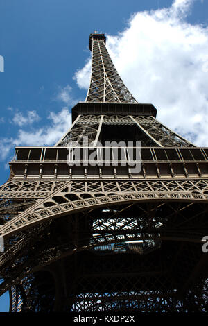Eiffel tower from the bottom view with blue sky in summer - Stock Photo