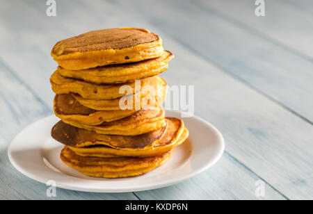 Stack of pumpkin pancakes on the plate - Stock Photo