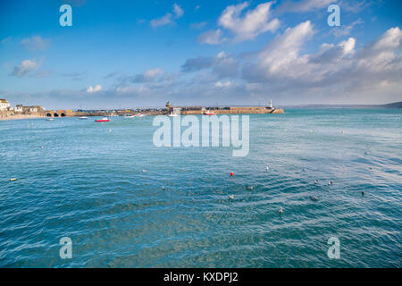 St Ives harbour. Brilliant blue sea and sky at full tide in popular British tourist desintation St Ives  in Cornwall. - Stock Photo