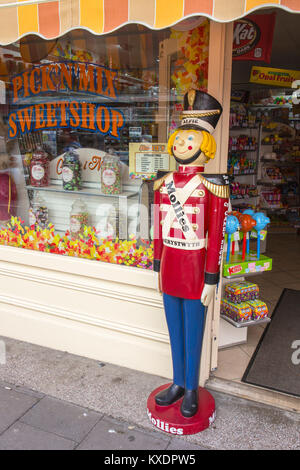 Alfie guarding outside Mollie's American Sweetshop in Aberystwyth Ceredigion Wales UK - Stock Photo