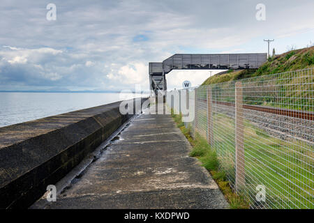 Footbridge over railway level crossing in Llanaber near Barmouth Wales UK - Stock Photo