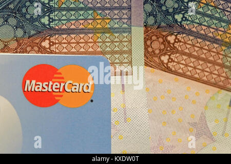 SALO, FINLAND - OCTOBER 19, 2014: MasterCard credit card sign close up over Euro cash. MasterCard Brings Contactless - Stock Photo