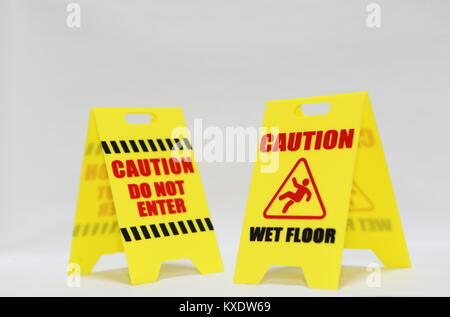 Caution do not enter and wet floor signage isolated - Stock Photo