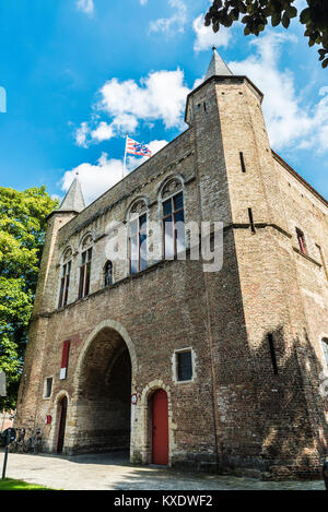 Gentpoort (Gate of Ghent) in the medieval city of Bruges, Belgium - Stock Photo