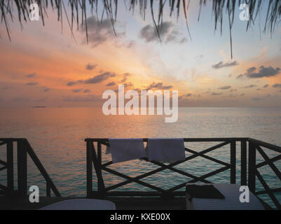Relaxing view of open sea at dawn from water bungalow room window. The image taken at Maldives tropical island resort - Stock Photo