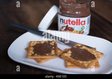 selangor, Malaysia - Jan 9th 2018 : nutella chocolate spread on wooden table. Nutella is manufactured by the Italian - Stock Photo