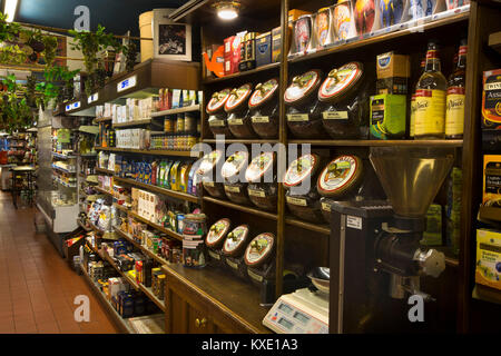 UK, England, Cheshire, Nantwich, Hospital Street, AT Welch (Austin's) grocer's shop shelves, coffee jars - Stock Photo