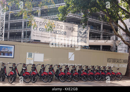 A docking station of London Santander bicycles waiting to be hired - Stock Photo