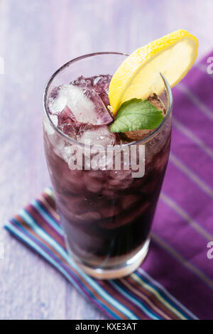 elderberry vodka, red currant vodka ,elderberry syrup, sparkling water, lime juice - Stock Photo