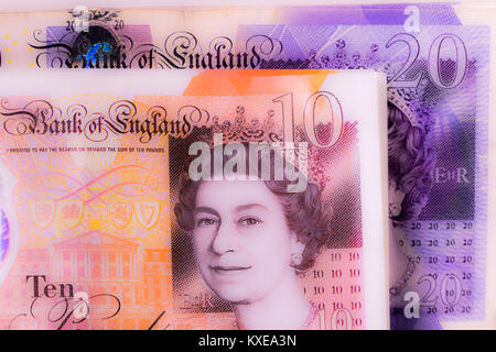 UK Sterling Currency - new notes and coins for 2018. new £1 coins and £5 and £10 notes currency ...