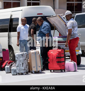Cape Town South Africa. December 2017, Holidaymakers luggage being loaded for transportation to the next destination - Stock Photo