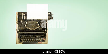 vintage mechanical  typewriter, on a light green background from avove - Stock Photo