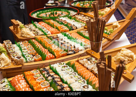 Sushi boat with chopsticks on white table.Sushi boat - Stock Photo