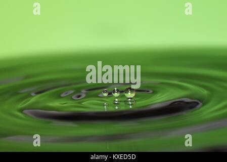 Water droplets photography drip drop shimmer pools of water reflecting light creating macro stunning images - Stock Photo