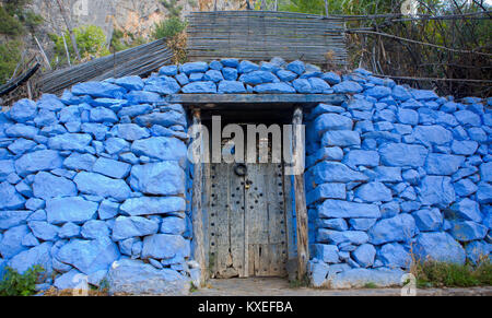 Traditional powder blue painted house facade and door in the historical Medina of Chefchaouen, Morocco - Stock Photo