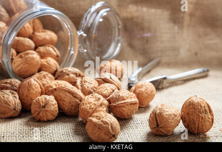 Walnuts and a nutcracker on a table - Stock Photo