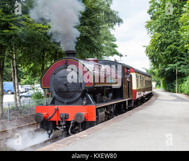 Victor, a preserved steam locomotive, departs Lakeside Station.  The station is on the Lakeside and Haverthwaite - Stock Photo