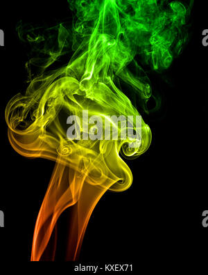 A streams of colored smoke on black background - Stock Photo