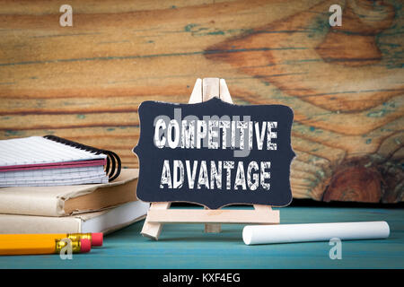 Competitive Advantage. small wooden board with chalk on the table - Stock Photo